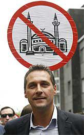 Heinz-Christian Strache with anti-mosque placard