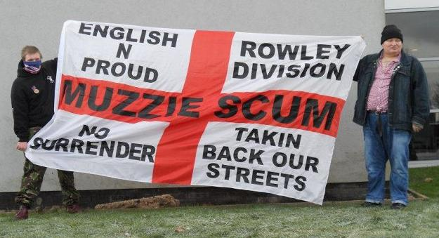 Kevin Smith with 'Muzzie Scum' banner