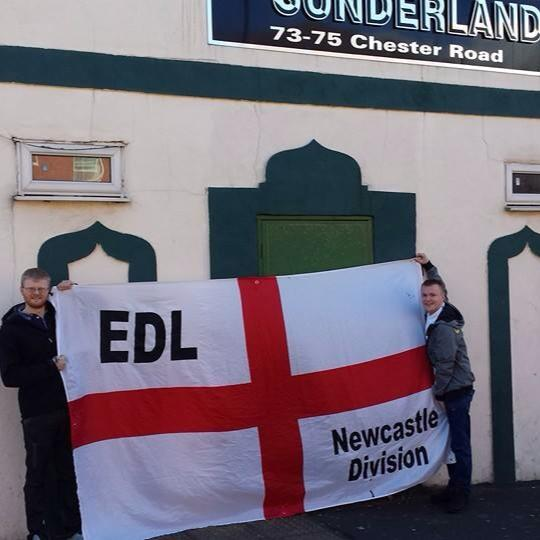Connor McIntosh with EDL banner outside Mosque of Sunderland