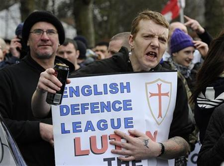 A supporter of the English Defence League gestures during a demonstration in Luton