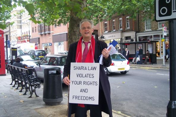 Magnus Nielsen with anti-sharia placard