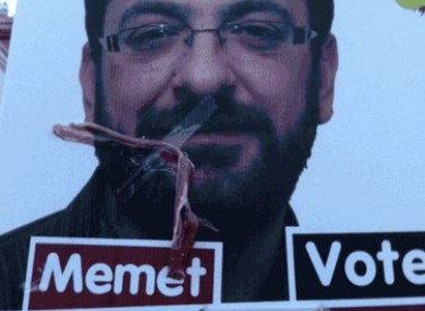 Memet Uludag poster defaced with bacon