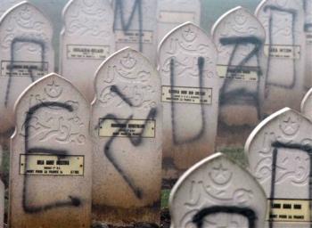 Muslim graves defaced