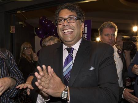 Nenshi reacts after he was elected Calgary mayor for a second term in Calgary